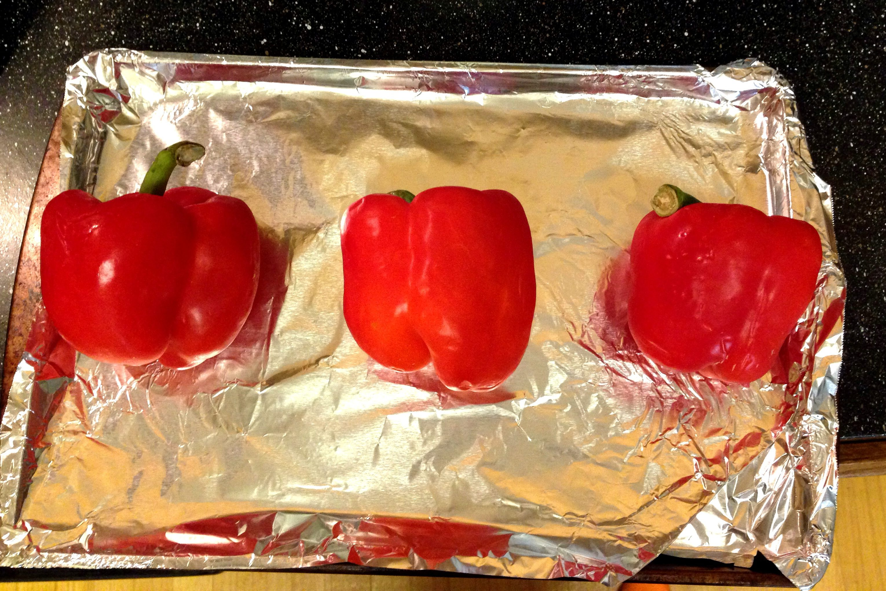 Place dry peppers on a baking sheet while you preheat your oven broiler.