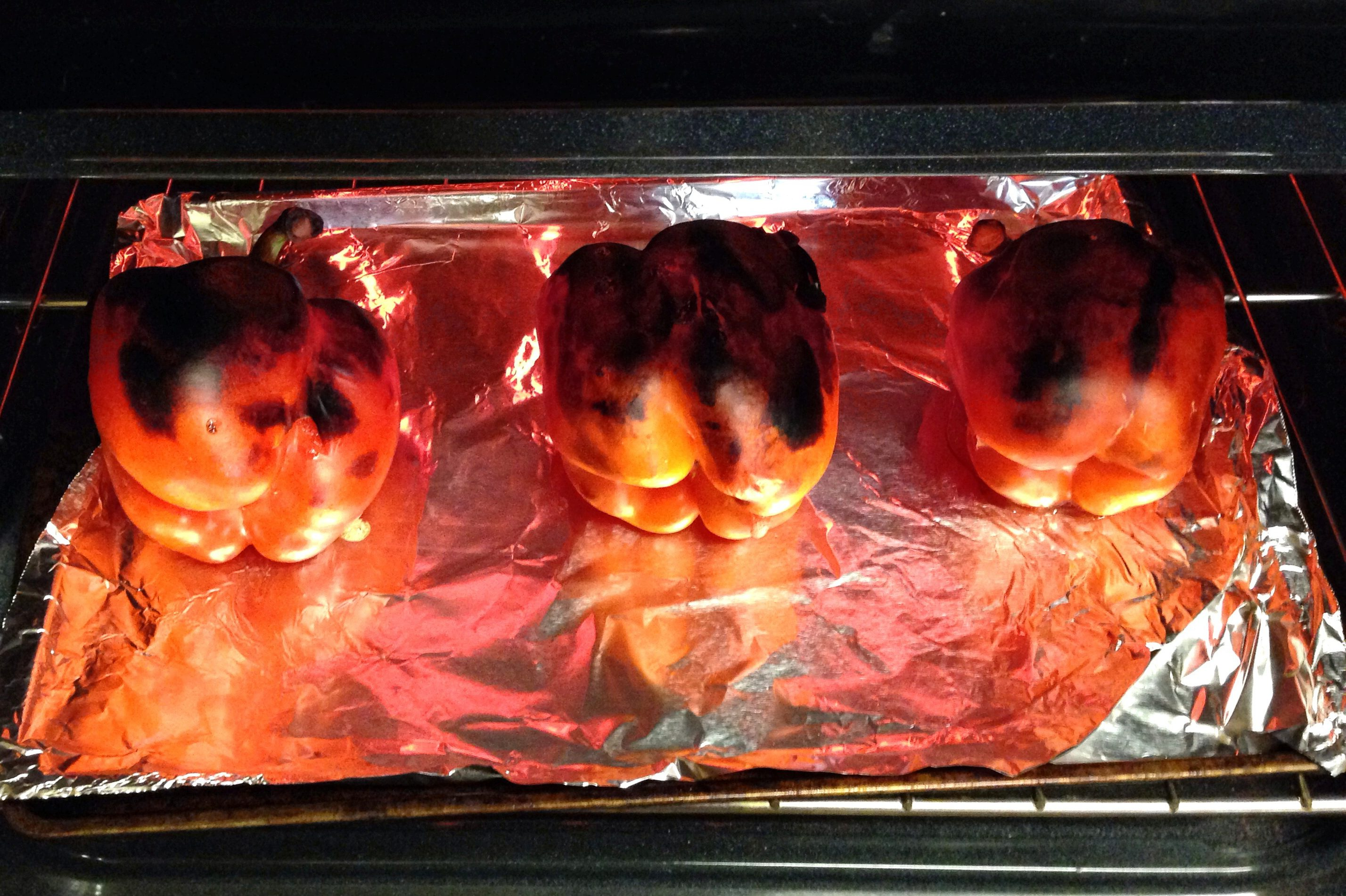 Step Two: Place peppers directly under the broiler, turning on each side to all sides are completely black.